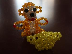 金猴献宝(串珠)